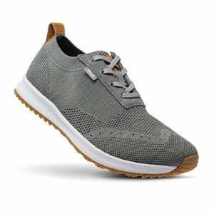 Image of a grey, white, and tan knit golf shoe. One of the best golf shoes.